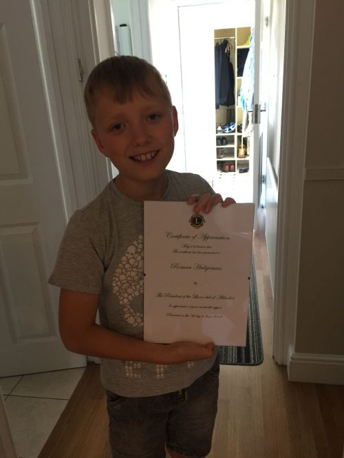 Roman with his appreciation certificate